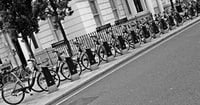grayscale photo of parked bikes