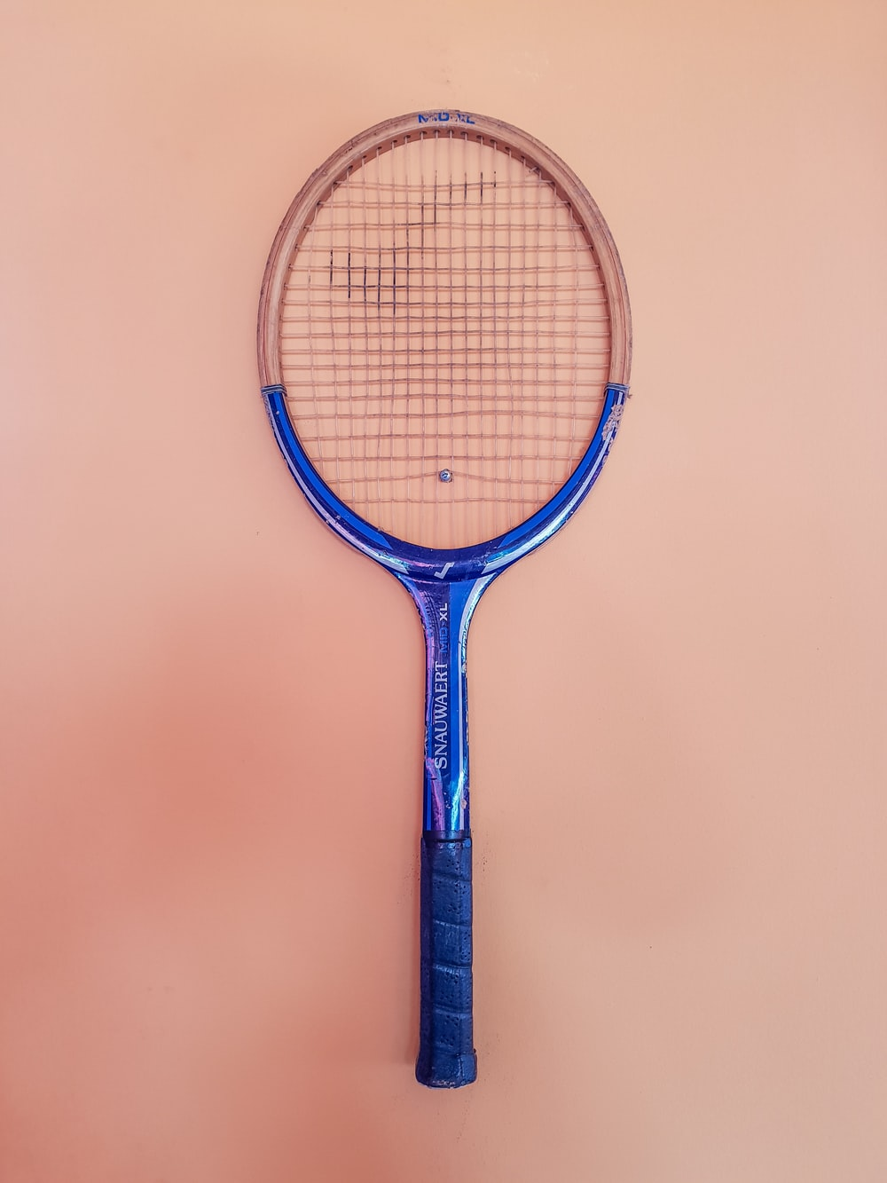 blue and brown tennis racket