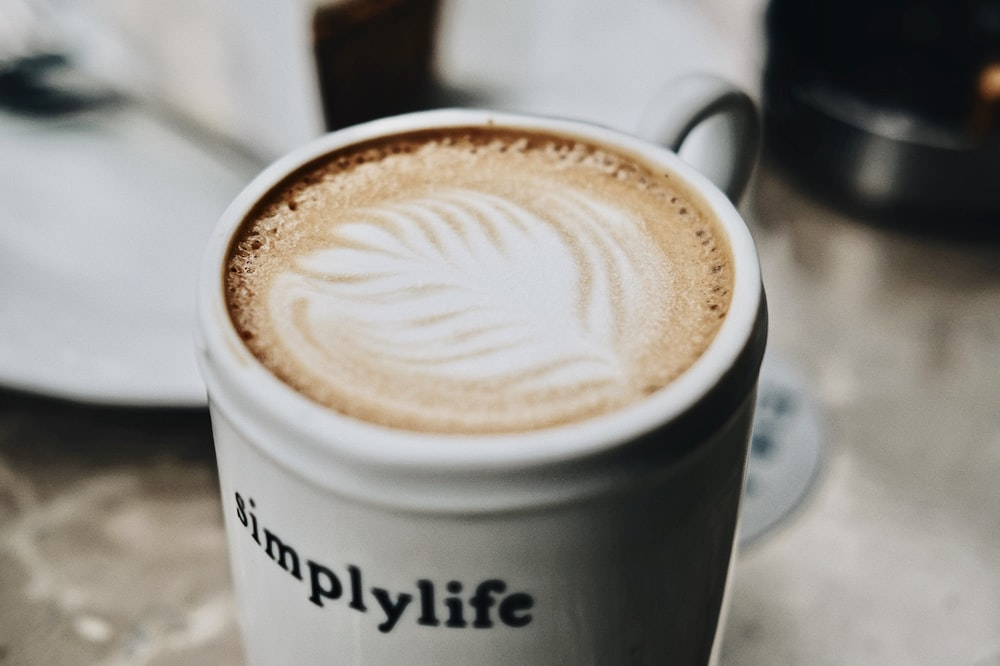 mug of coffee on white surface
