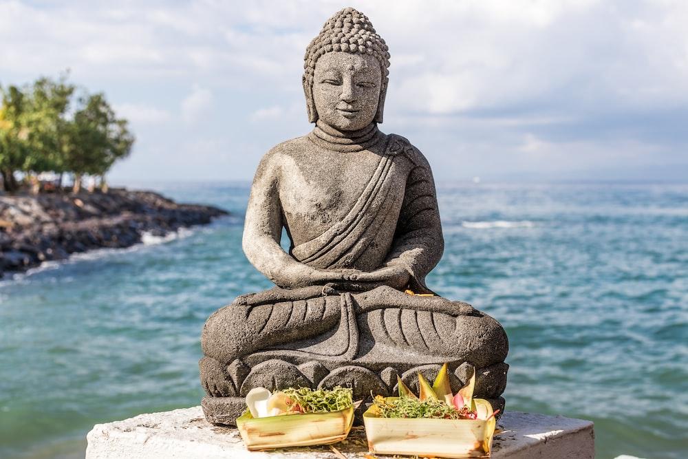 Gautama Buddha with two basket of foods