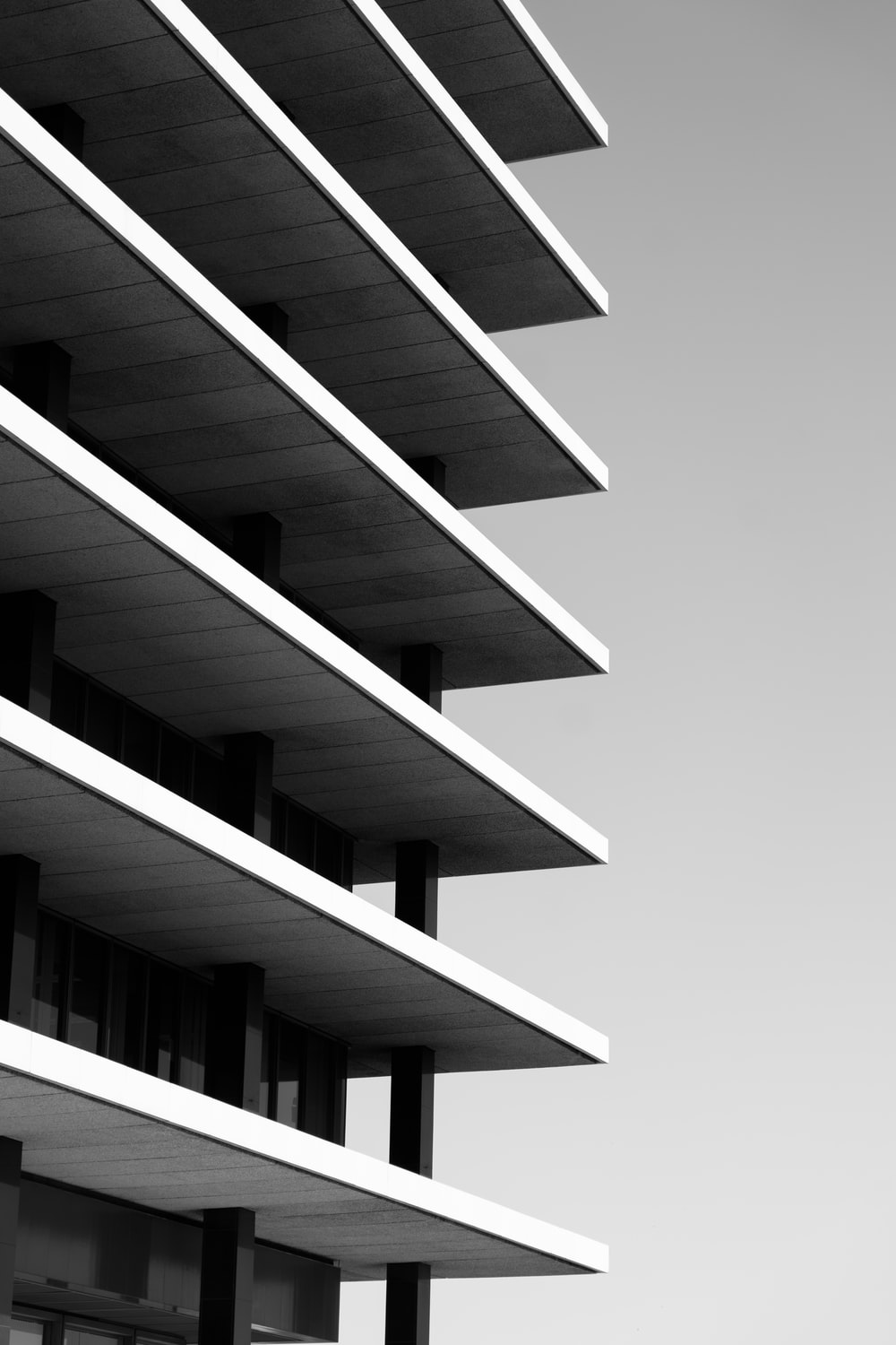 greyscale photo of high rise building