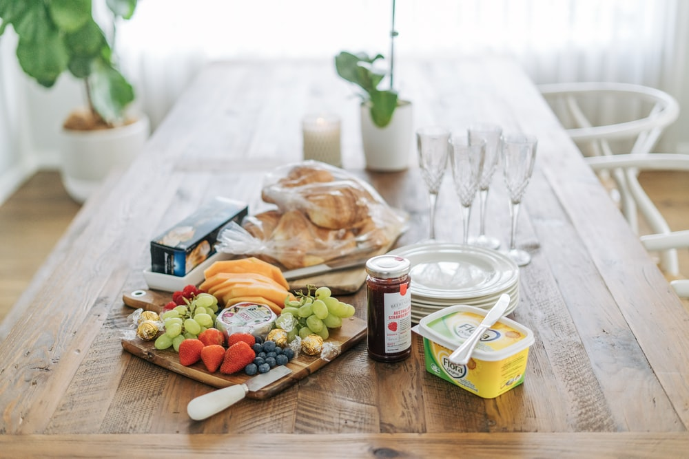 assorted fruits and sread on table