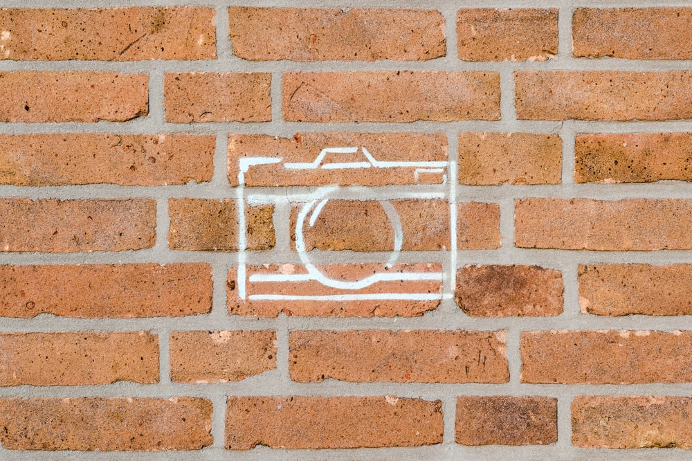 brick wall with camera sketch