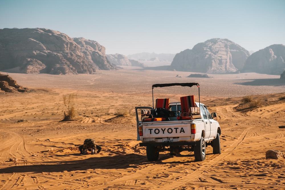 white Toyota pickup truck on desert