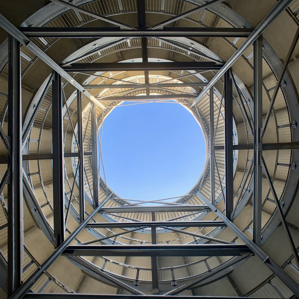low-angle photography of metal scaffolding inside building