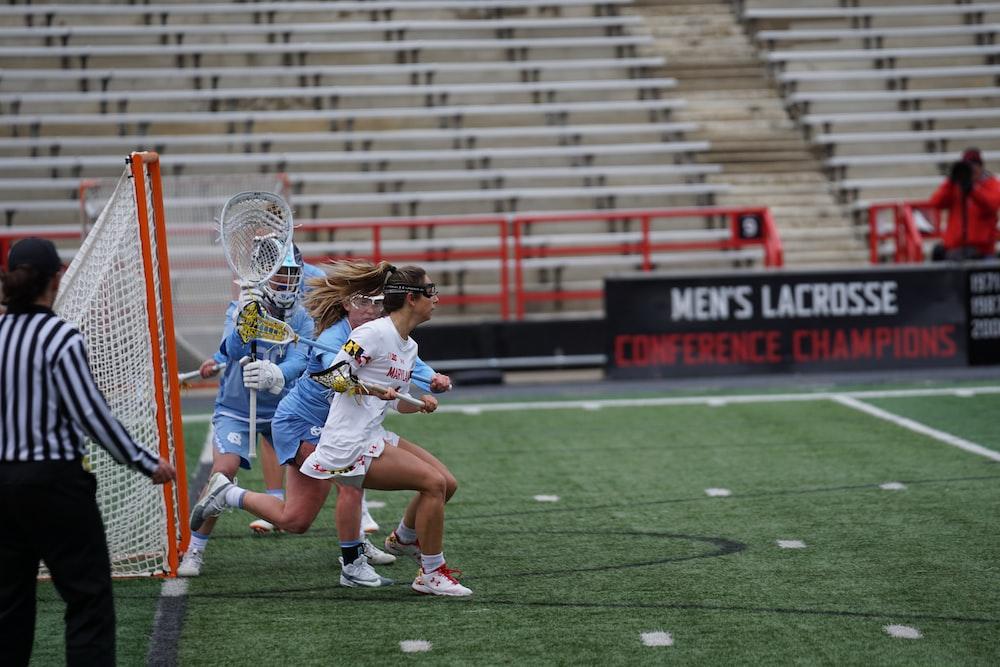 women playing lacrosse