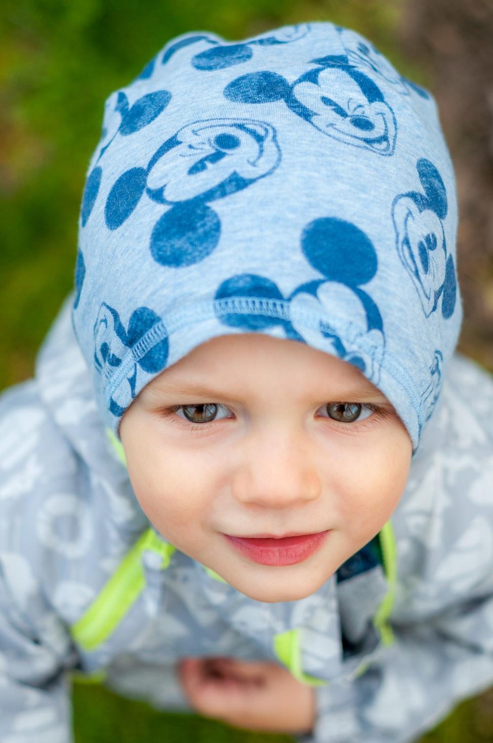 baby wearing blue knit cap