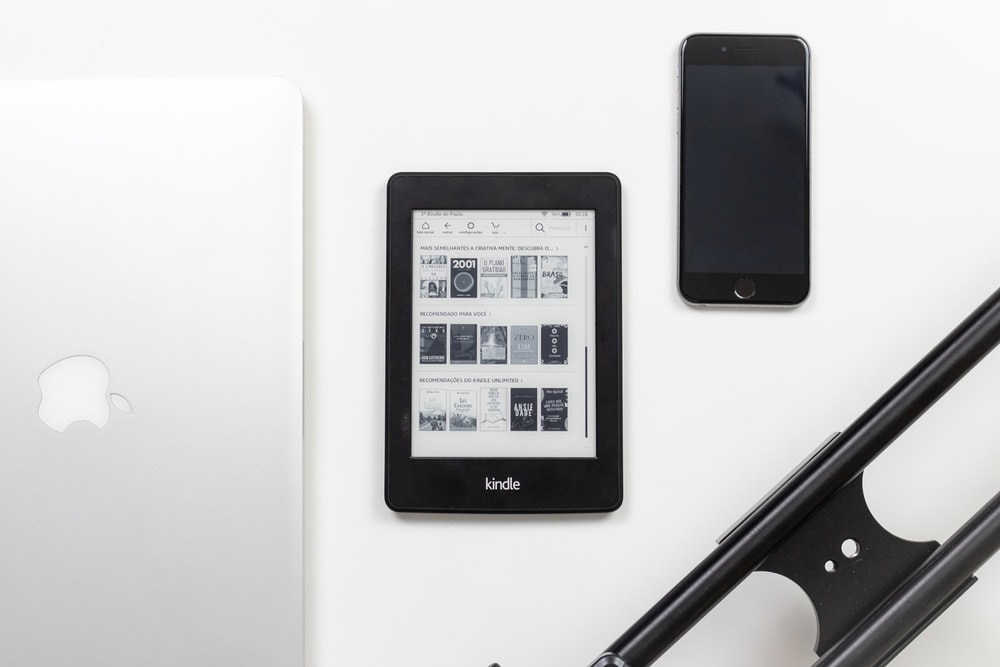 black Amazon Kindle e-book reader on white surface