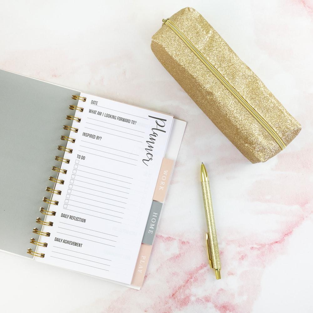 pen beside note book