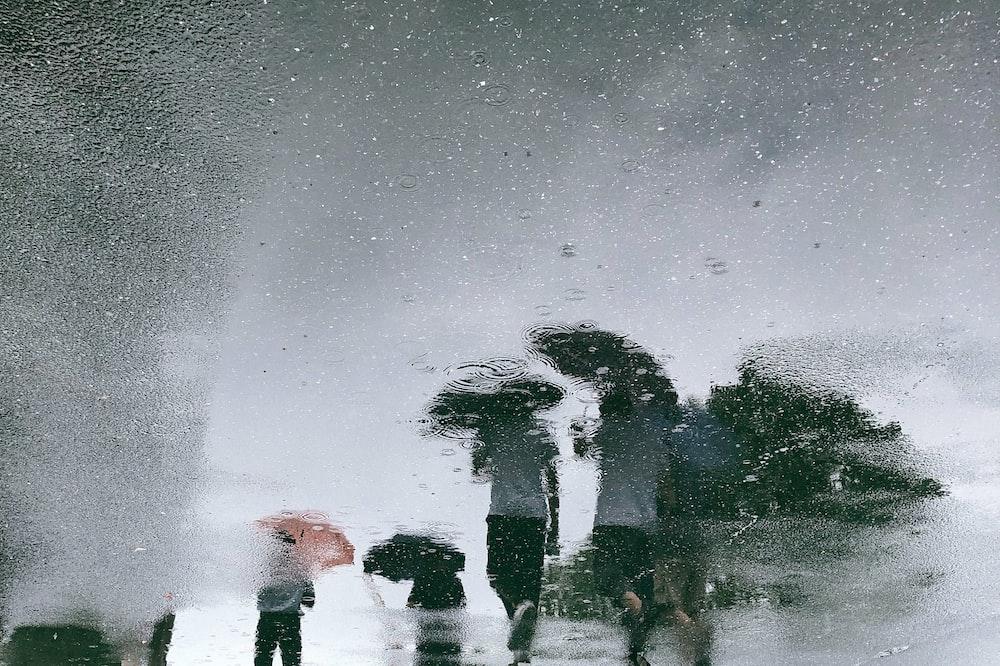 glass moist photo of people walking on street