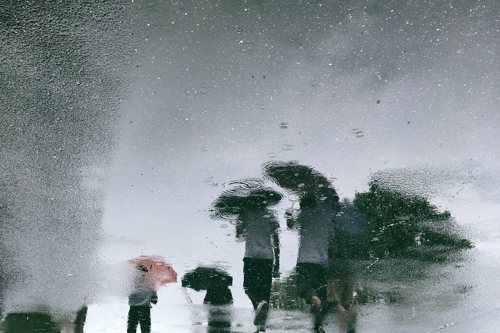 glass moist photo of people walking on street