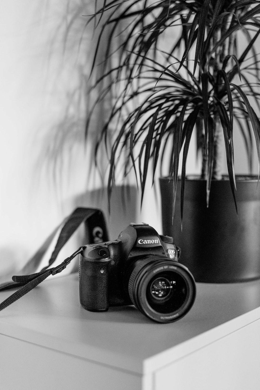 grayscale photo of Canon camera