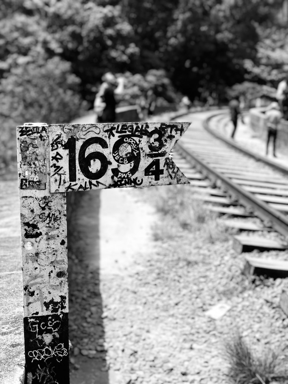 grayscale photo of train 169 3/4 signage