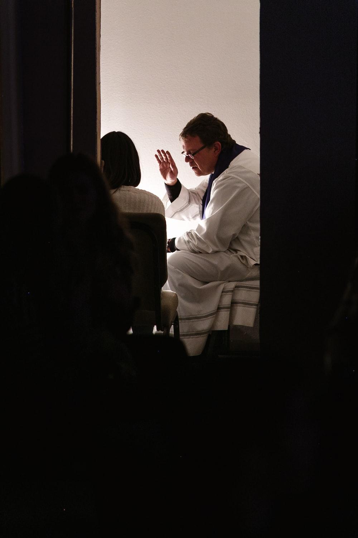 man wearing white bathrobe sitting on bed