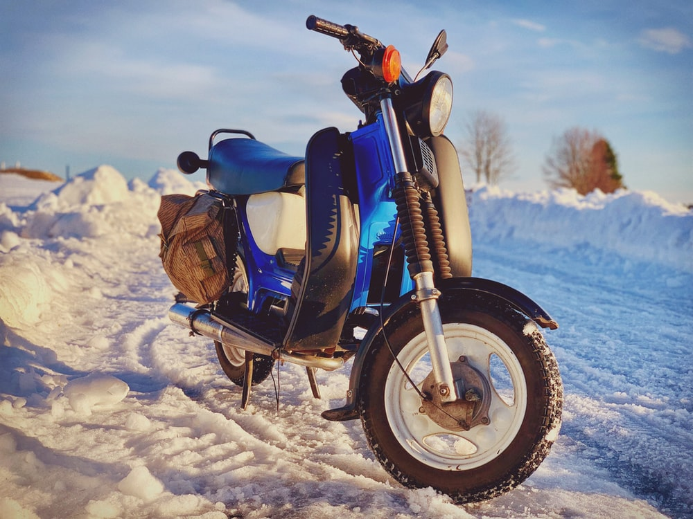 blue and white motor scooter
