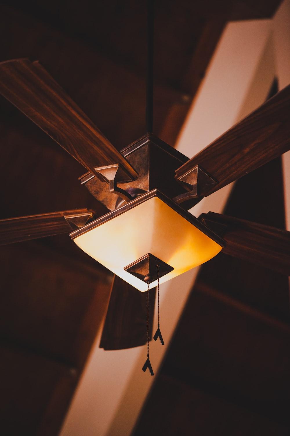 brown 5-blade ceiling fan