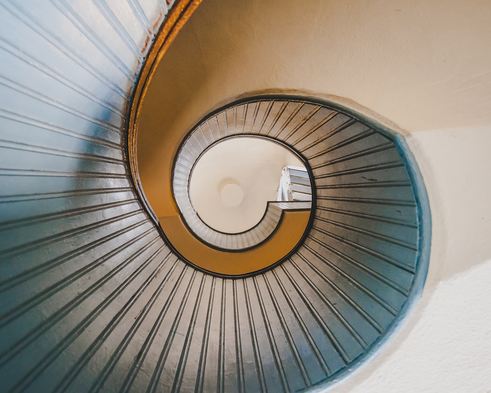 low angle photography of spiral ladder