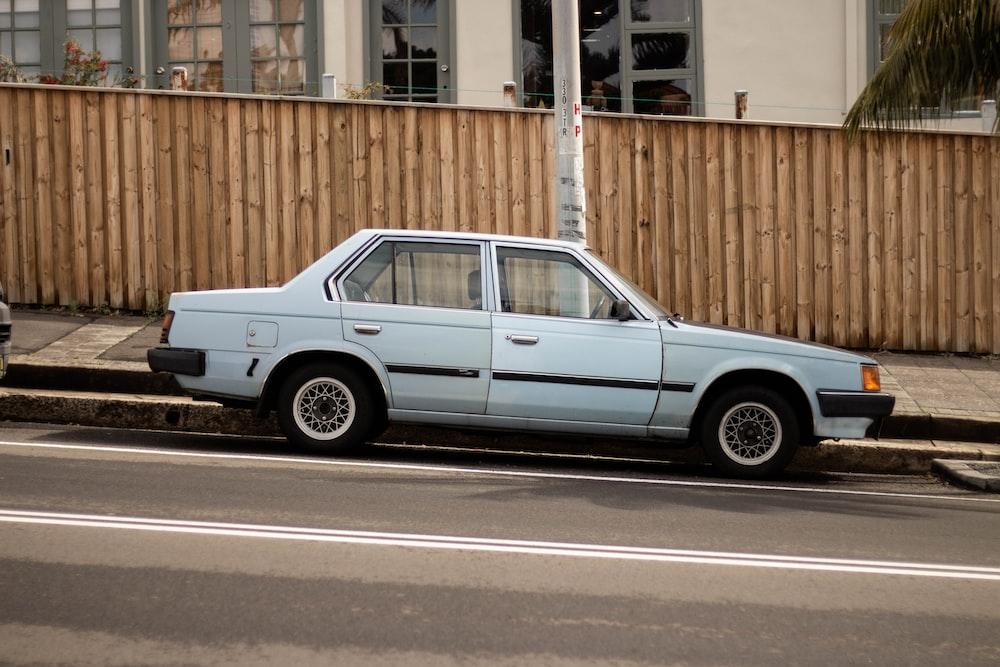 white sedan on asphalt rode