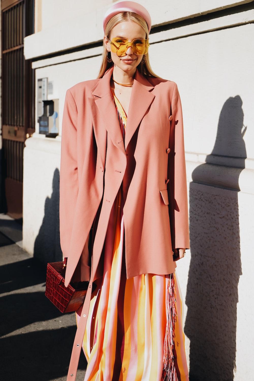 woman wearing brown suit jacket
