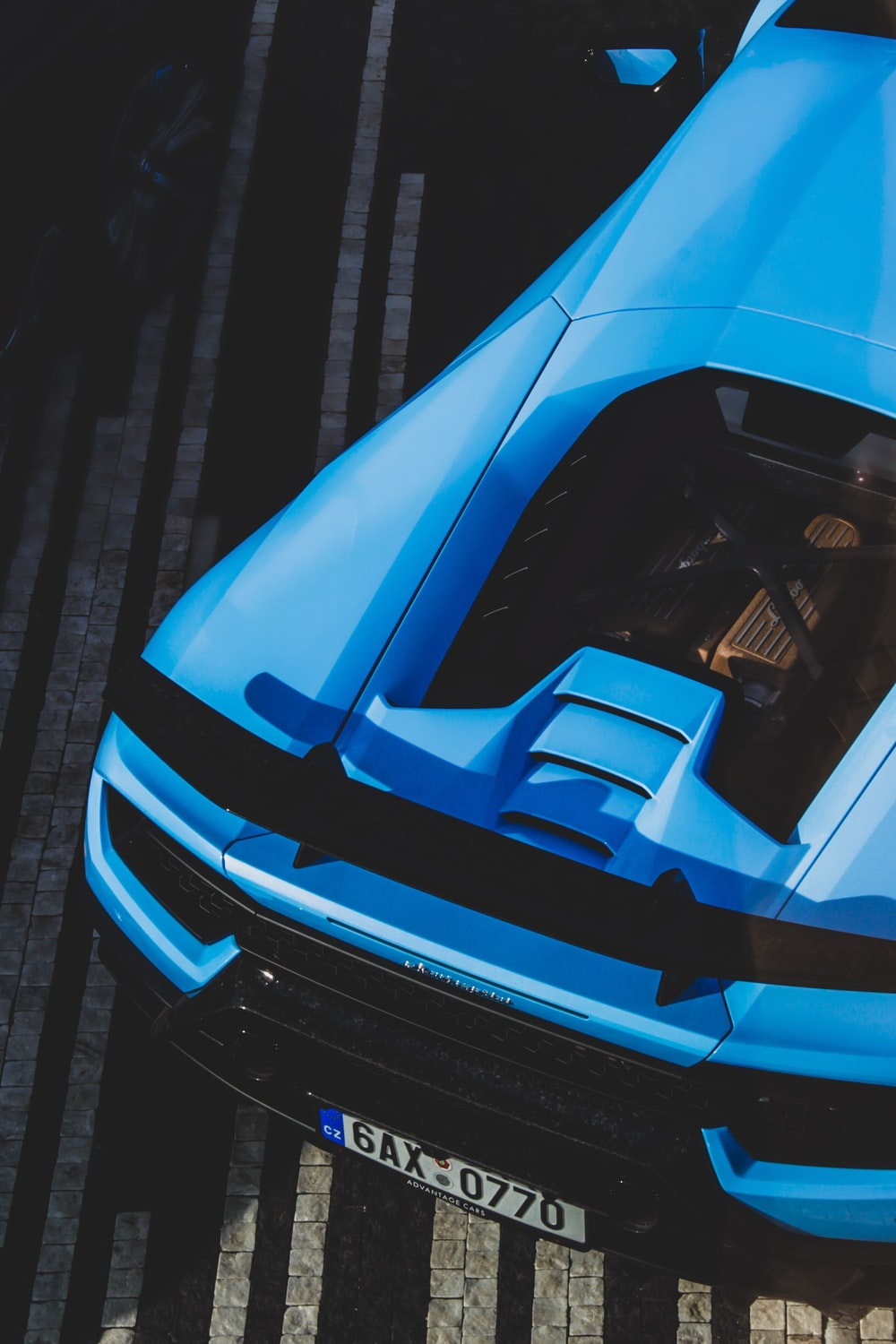 blue coupe in high-angle photo