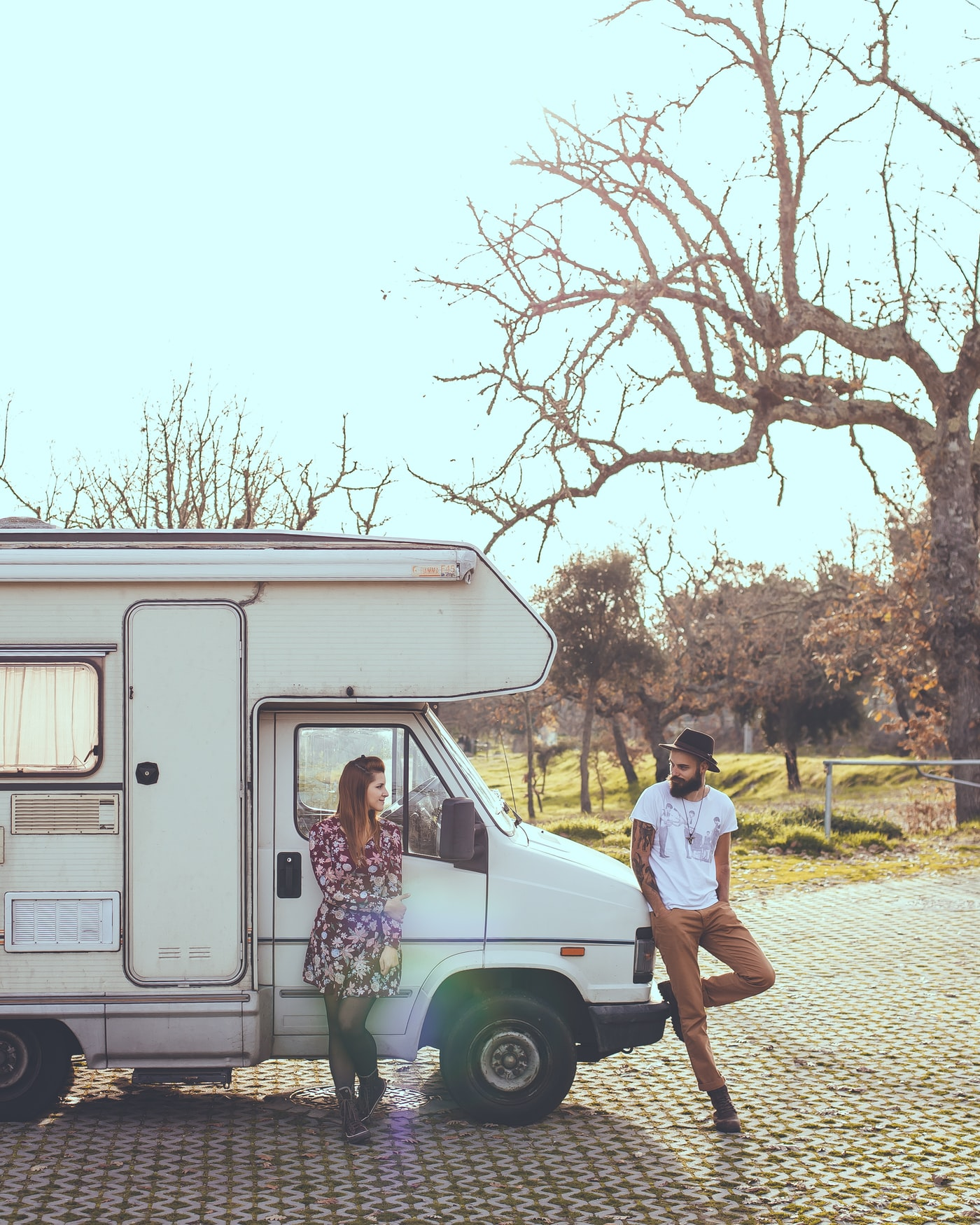 man and woman standing outside an RV