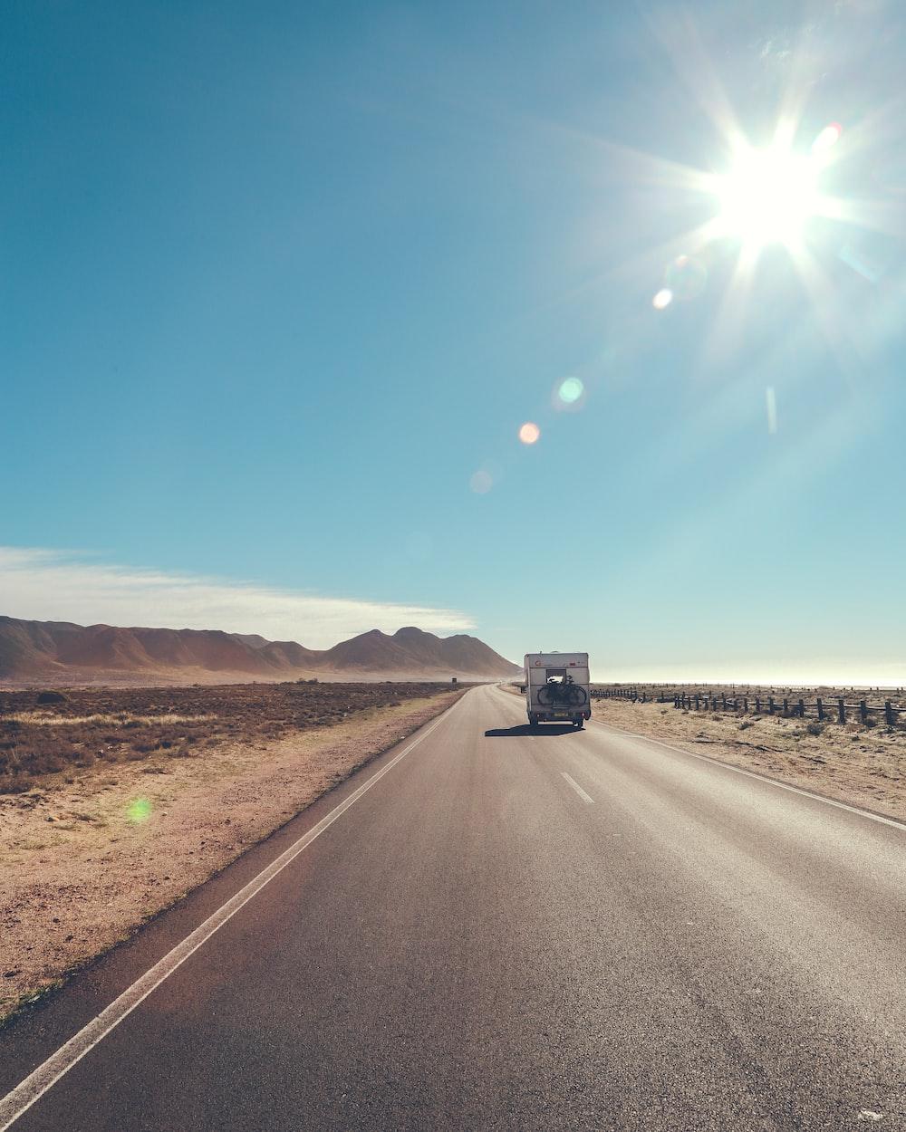 car on black asphalt road