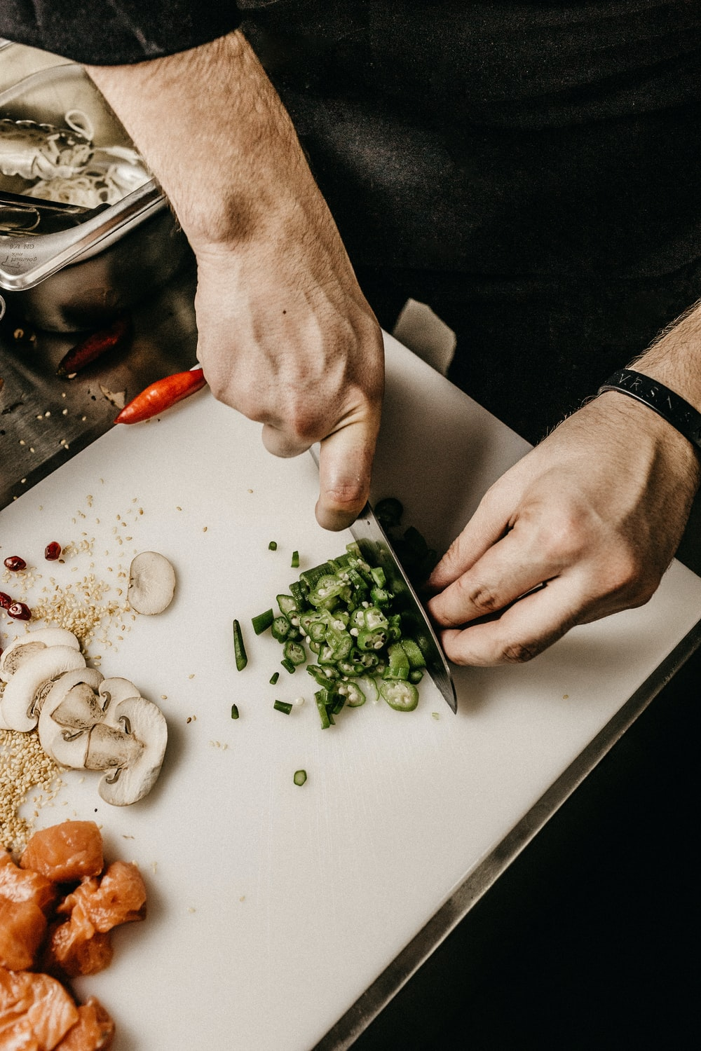 person slicing vegetable