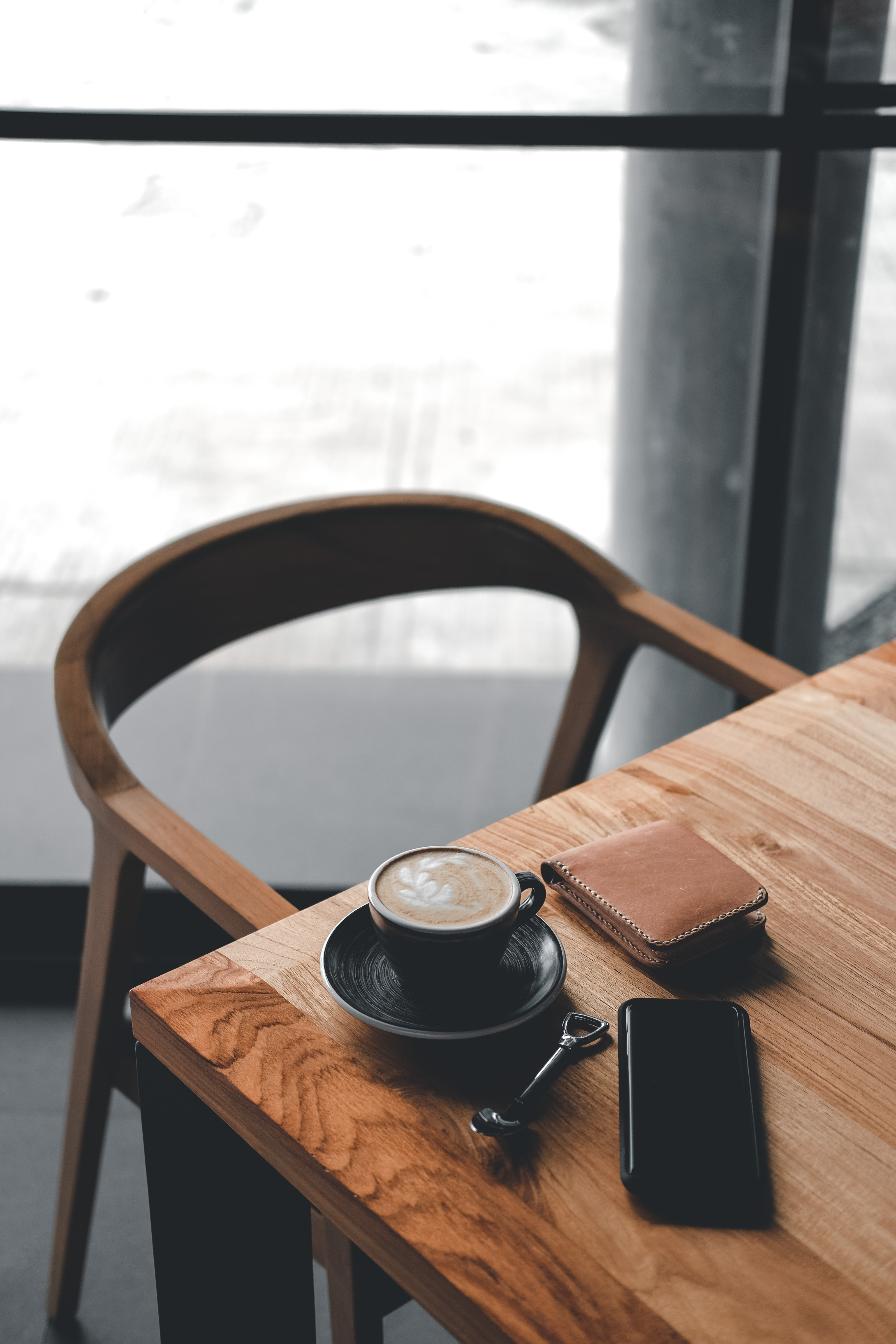 coffee in black cup on brown wooden table