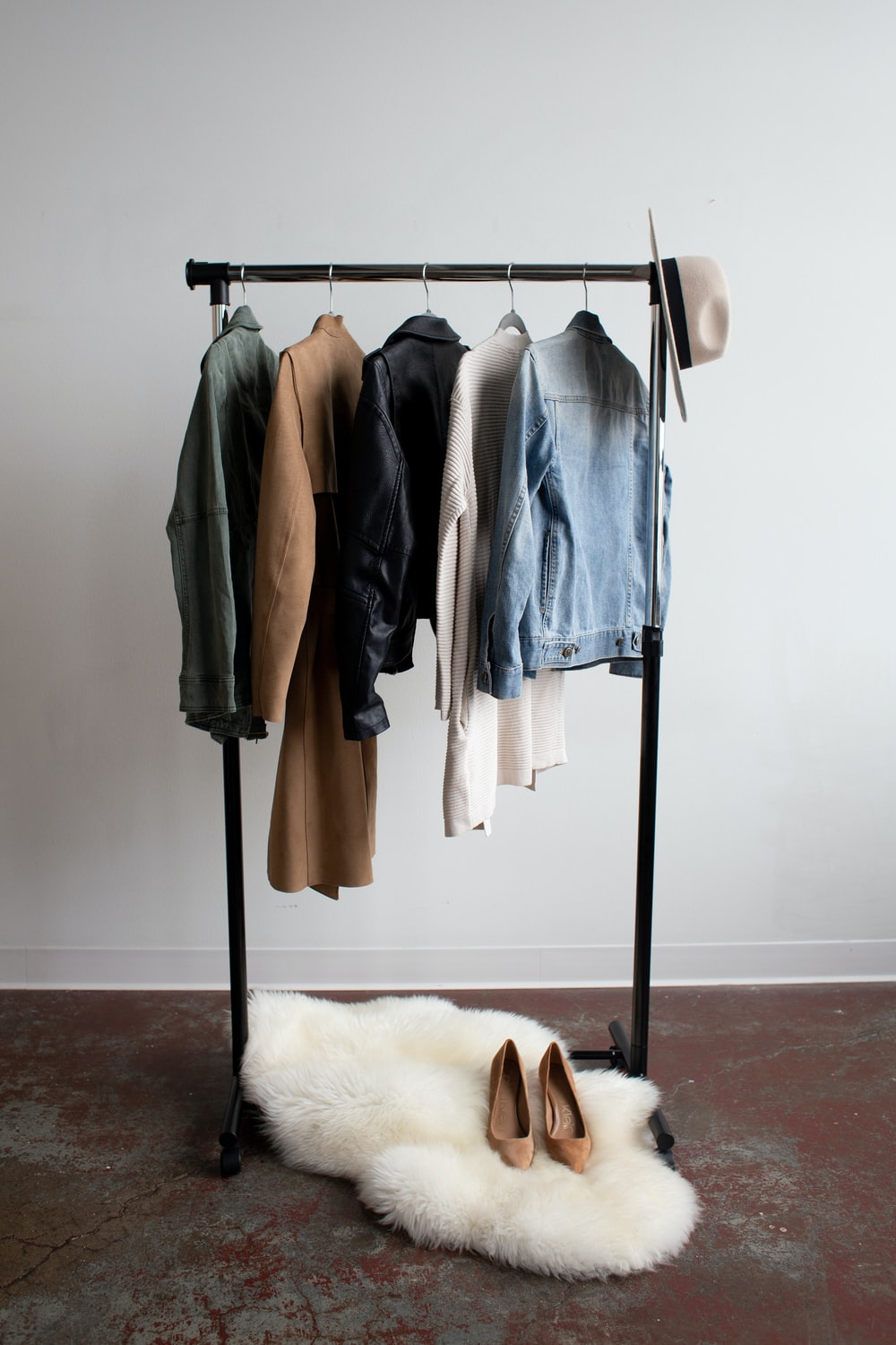 five jackets on clothes rack