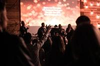 people at the concert praising Jesus Christ