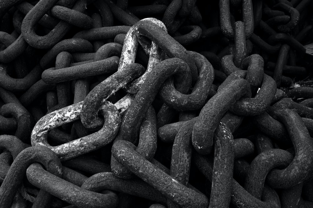 grayscale photography of metal chain