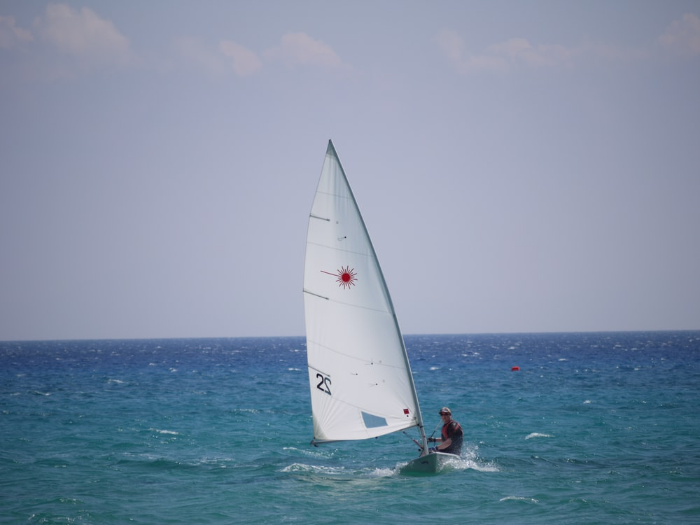 person sail surfing during daytime