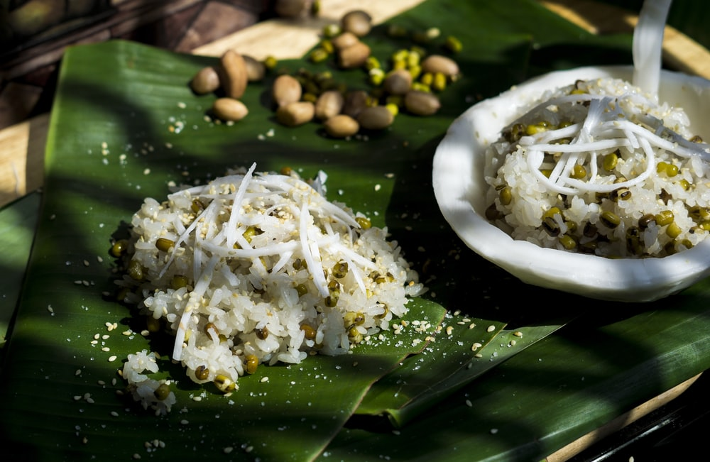 rice and beans on banana leaf