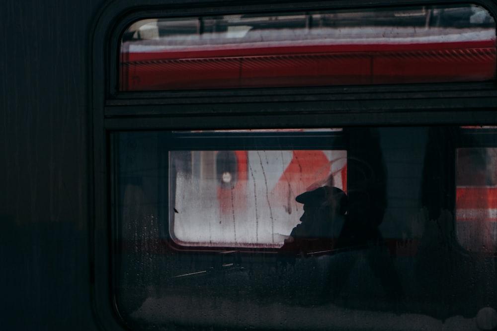 silhouette of man sitting inside train