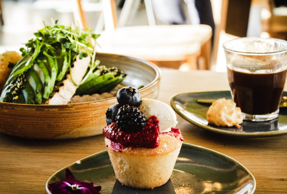 cupcake with berry toppings on plate