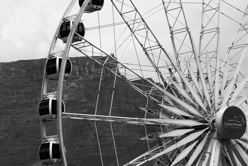 white and black Ferris wheel during daytime