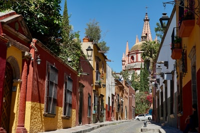 red and brown concrete buildings during daytime mexico zoom background