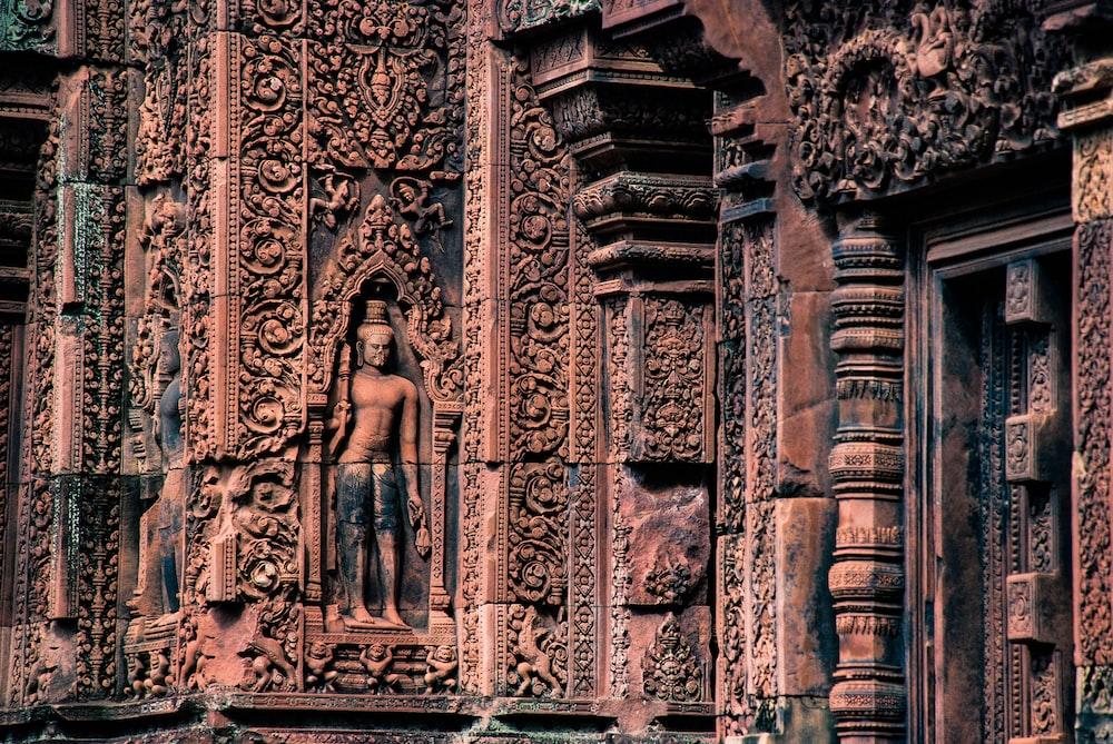 male statue on brown concrete building