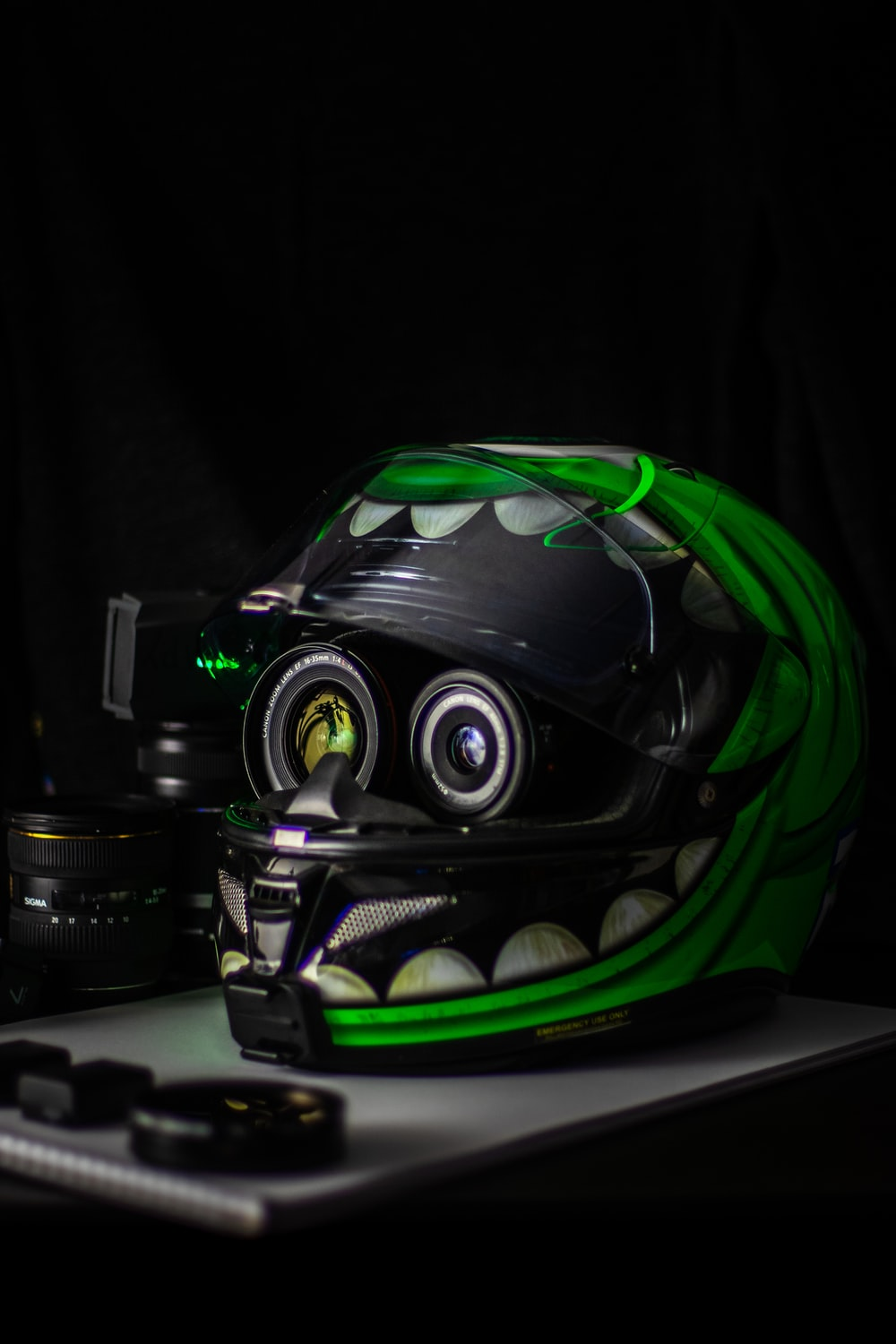 black and green full-face helmet on white wooden table