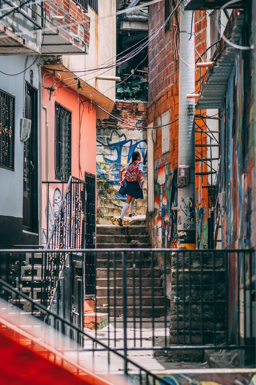 girl wearing uniform walking on stairs during daytime