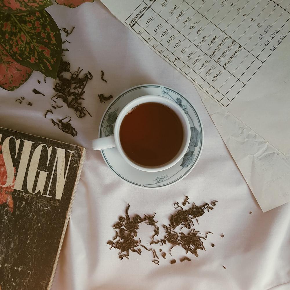 served coffee on white textile