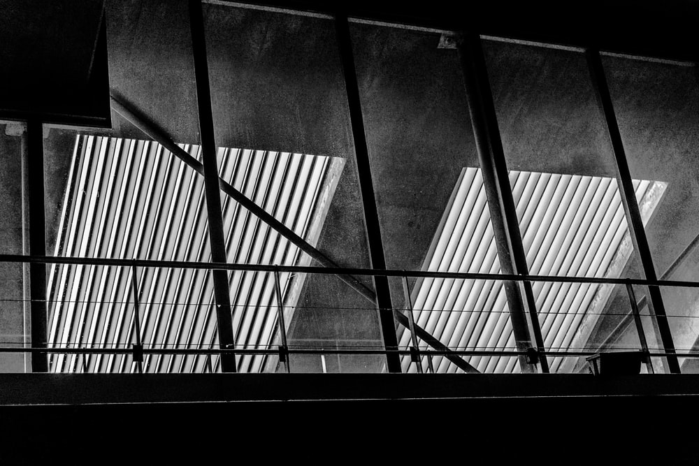 grayscale photography of building indoor