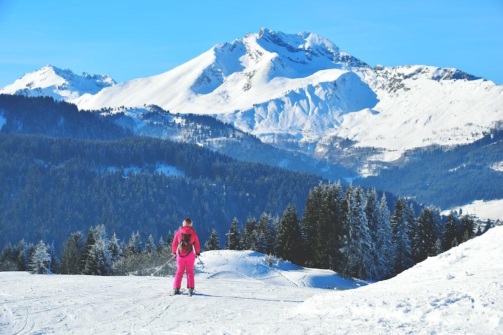 man standing on snowfield near mountain