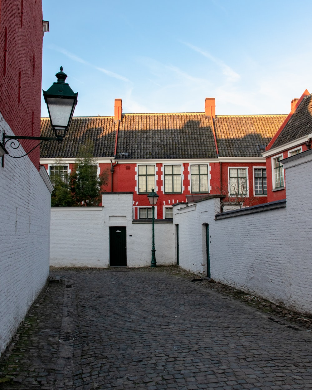 white and red concrete house during daytime