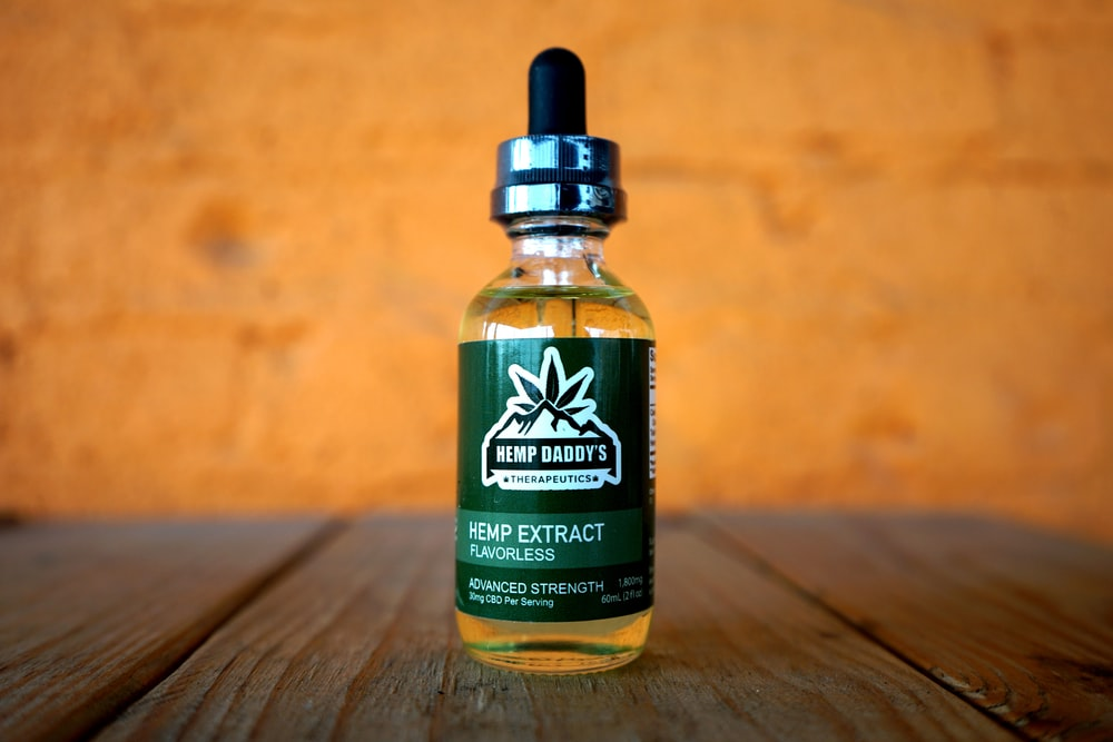 shallow focus photo of vape juice bottle showing front label