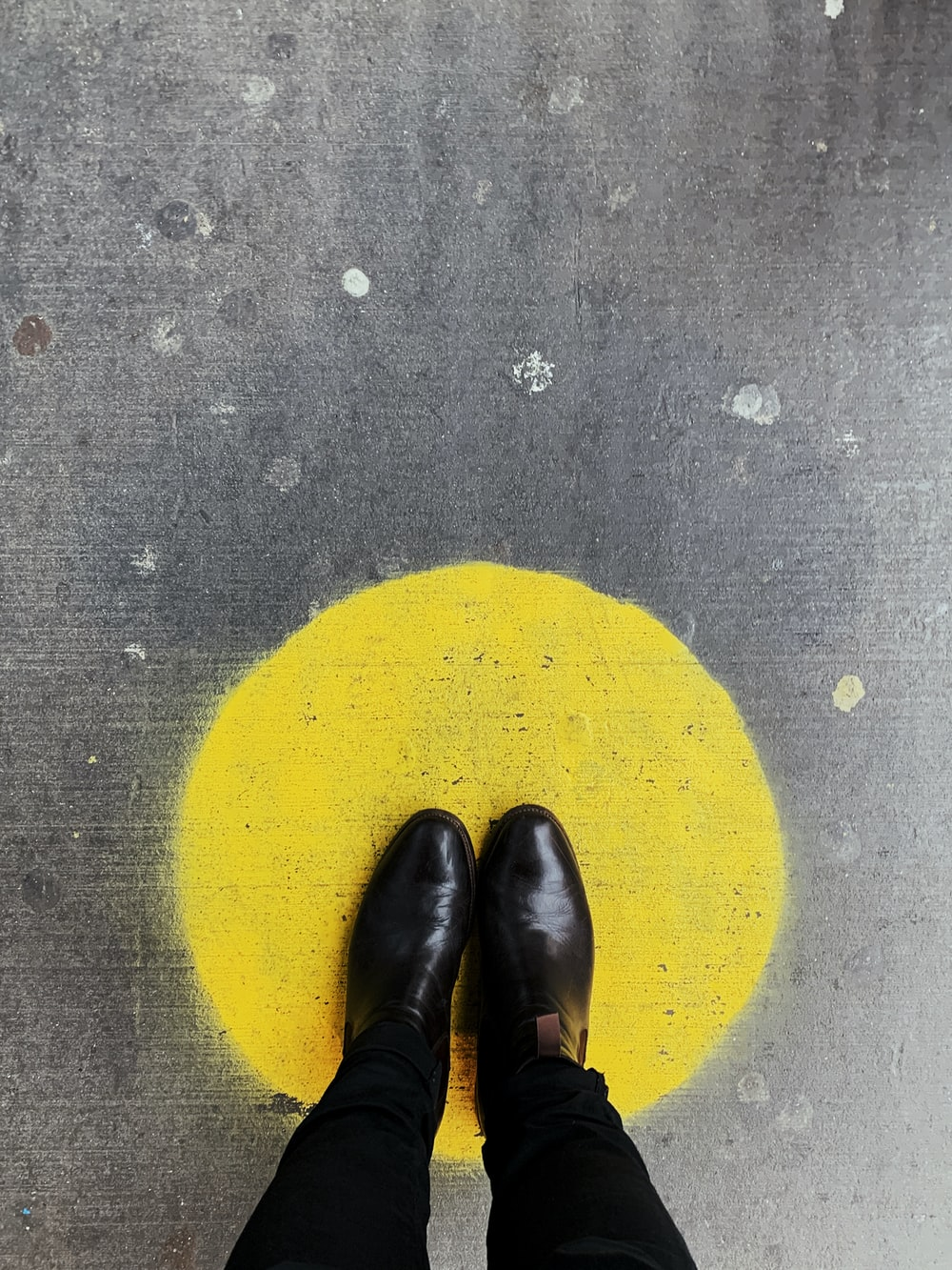 person standing on round yellow painted surface