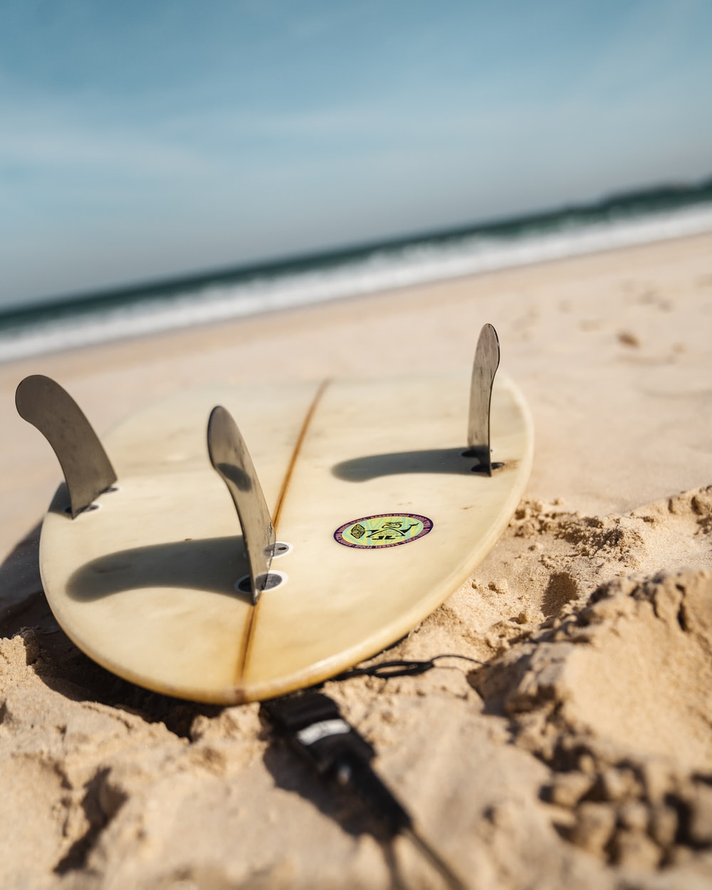 3-tail white surfboard