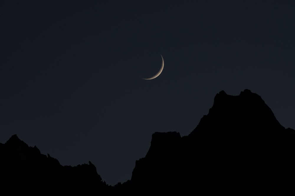 silhouette of mountain during nighttime