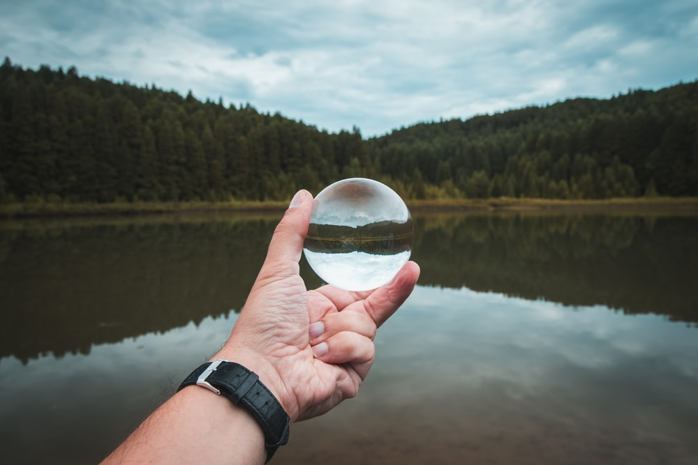 person holding clear ball