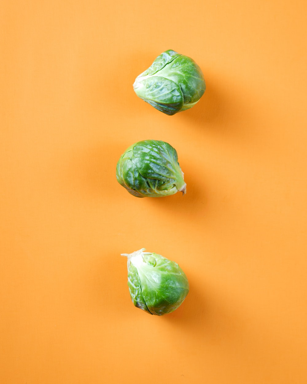 three green cabbage vegetables